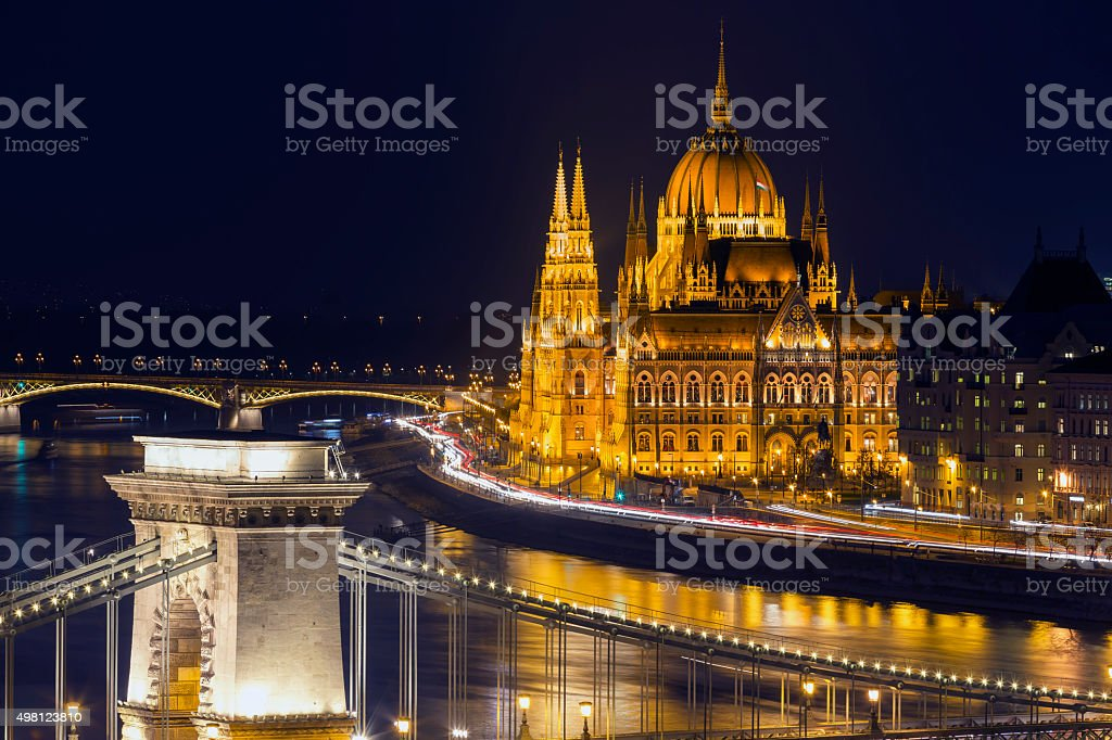 View of Chain Bridge and Parliament in Budapest at dusk stock photo