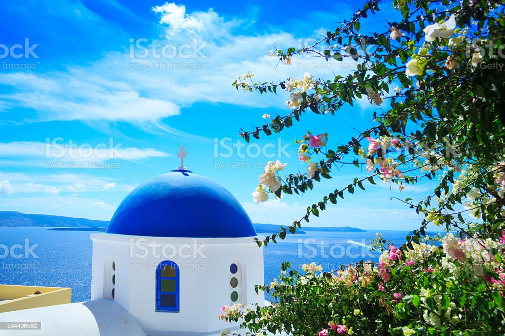 View of church dome with flowers, Santorini, Greece stock photo