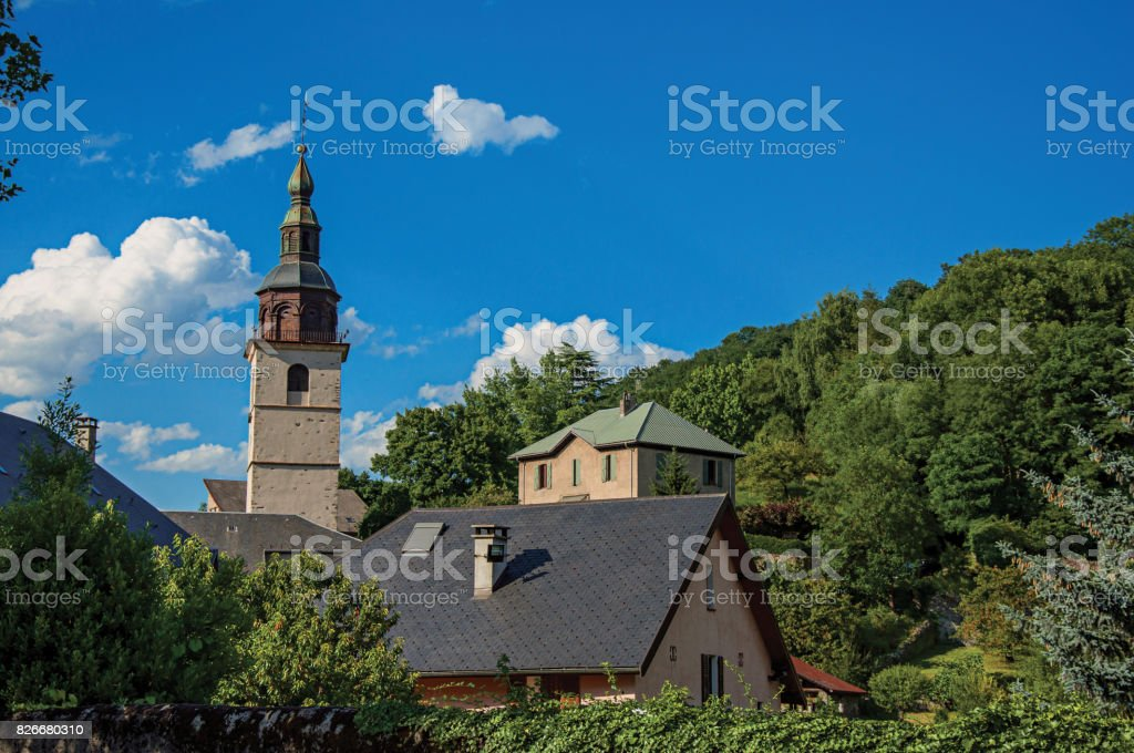 View of church steeple in the medieval village of Conflates. stock photo