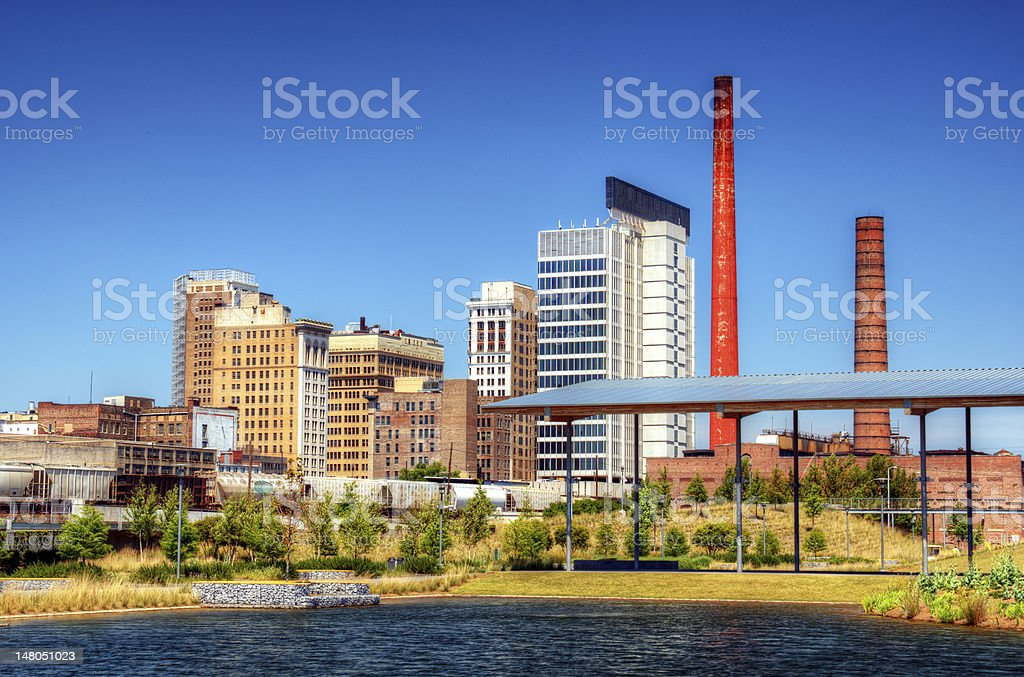 View of city sitting along a riverbank stock photo