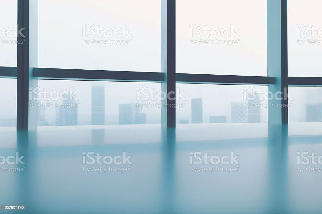 View of cityscape through windows in urban office stock photo