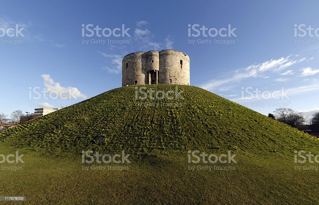 View of Cliffords Tower from bottom of steep hill stock photo