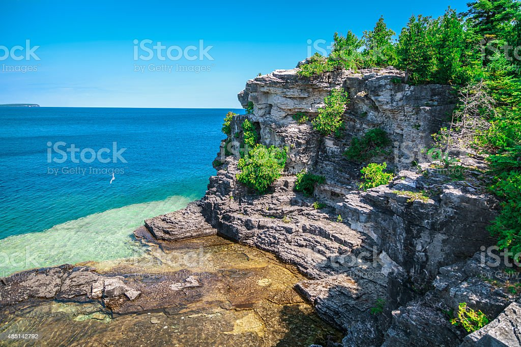 view of cliffs rocks above great Huron lake stock photo