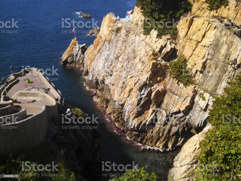 View of Cliffs where Daredevil Divers work Acapulco Mexico stock photo