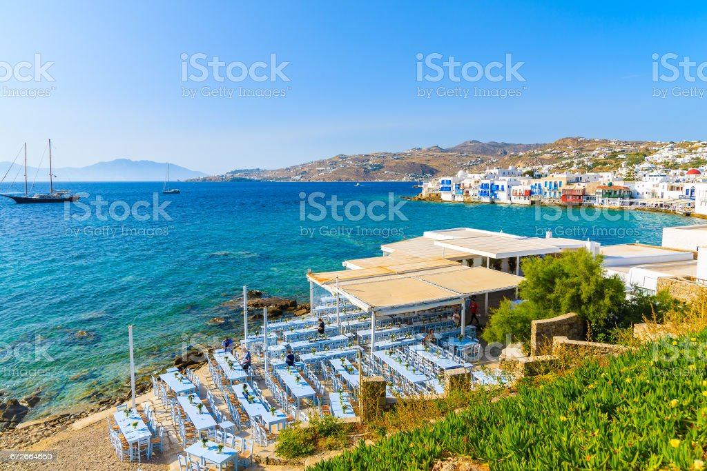 A view of coast and typical Greek tavern in Little Venice part of Mykonos town, Mykonos island, Greece stock photo