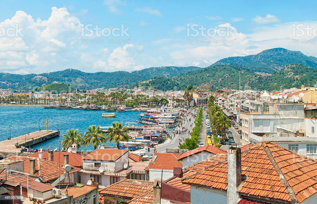 view of coastal resort city from tiled  roof top stock photo