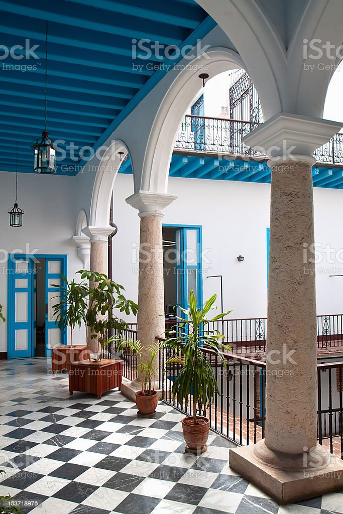View of colonial building interior with tropical flowers, Cuba royalty-free stock photo