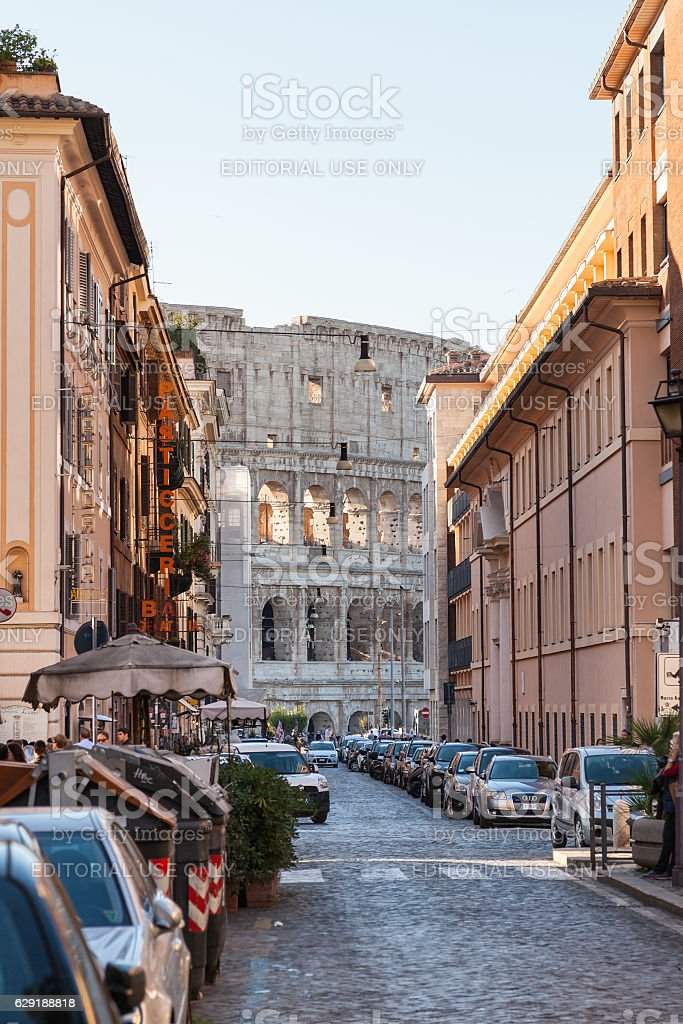 view of Colosseum building through street in Rome stock photo