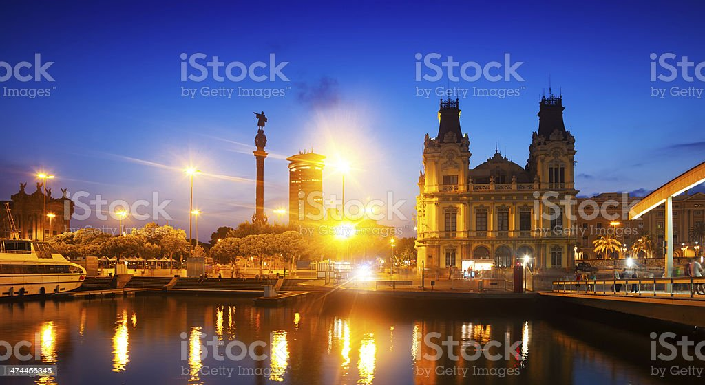 view of Columbus Quay from Port Vell in evening stock photo