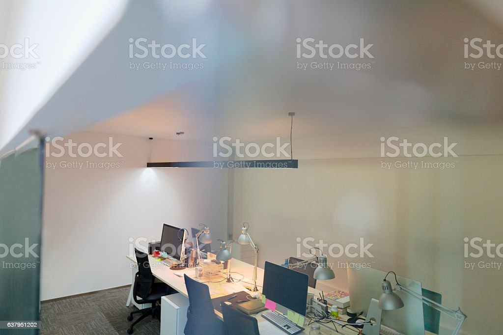 View of computer design studio office through glass wall stock photo