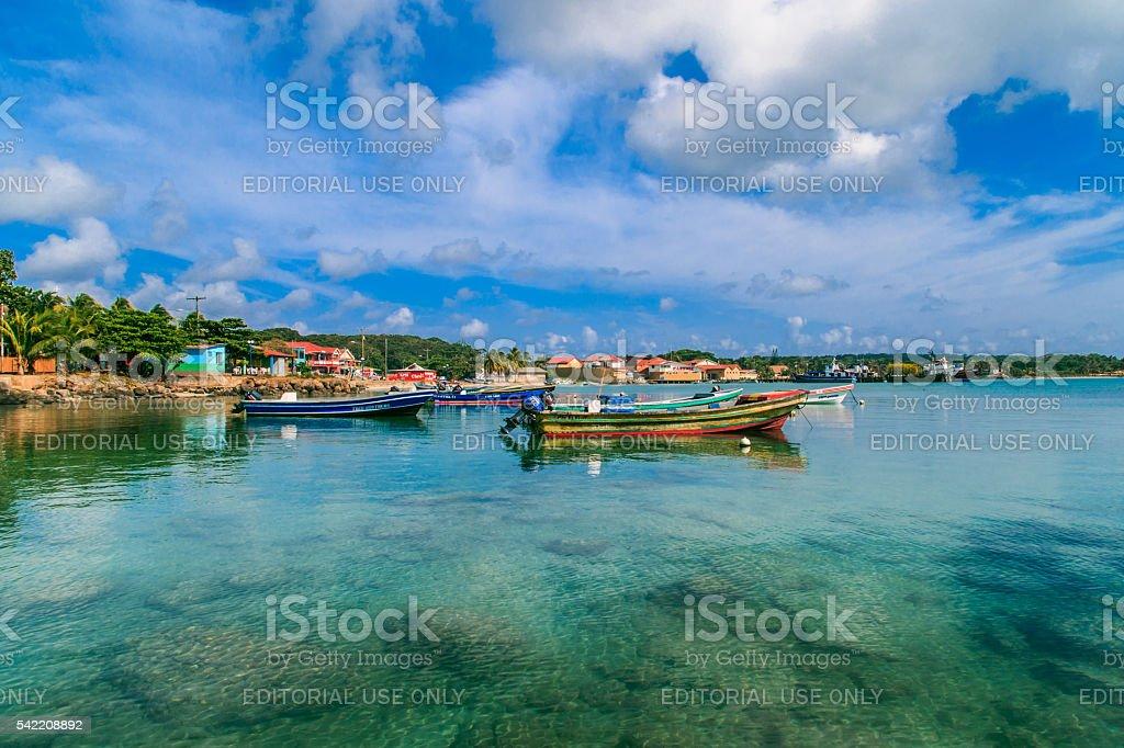 view of corn island Nicaragua. sea with boats, blue sky stock photo