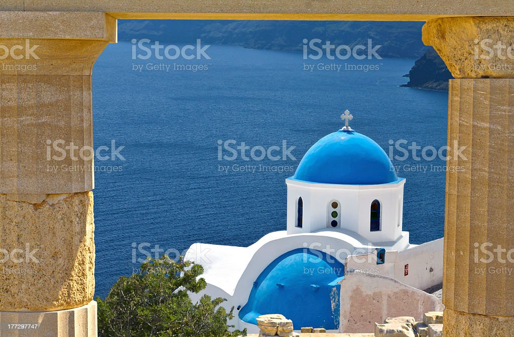 View of domed building and sea on Santorini Island, Greece stock photo