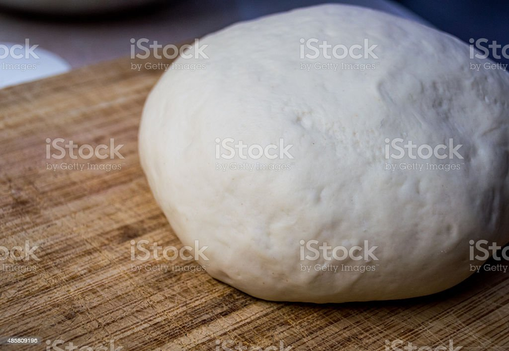 View of Dough Ball on a Wooden Kitchen Worktop royalty-free stock photo