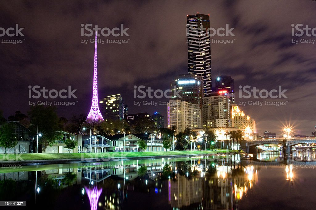 A view of downtown Melbourne lit up at night stock photo