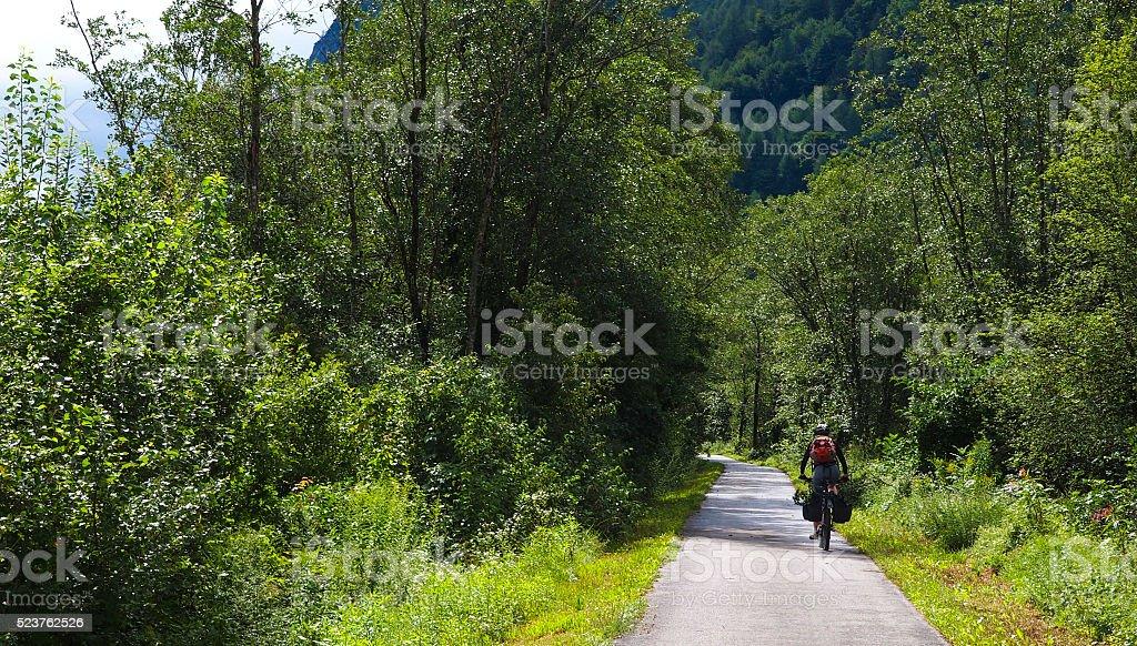 View of drau cycle path with biker near Lienz, Austria stock photo