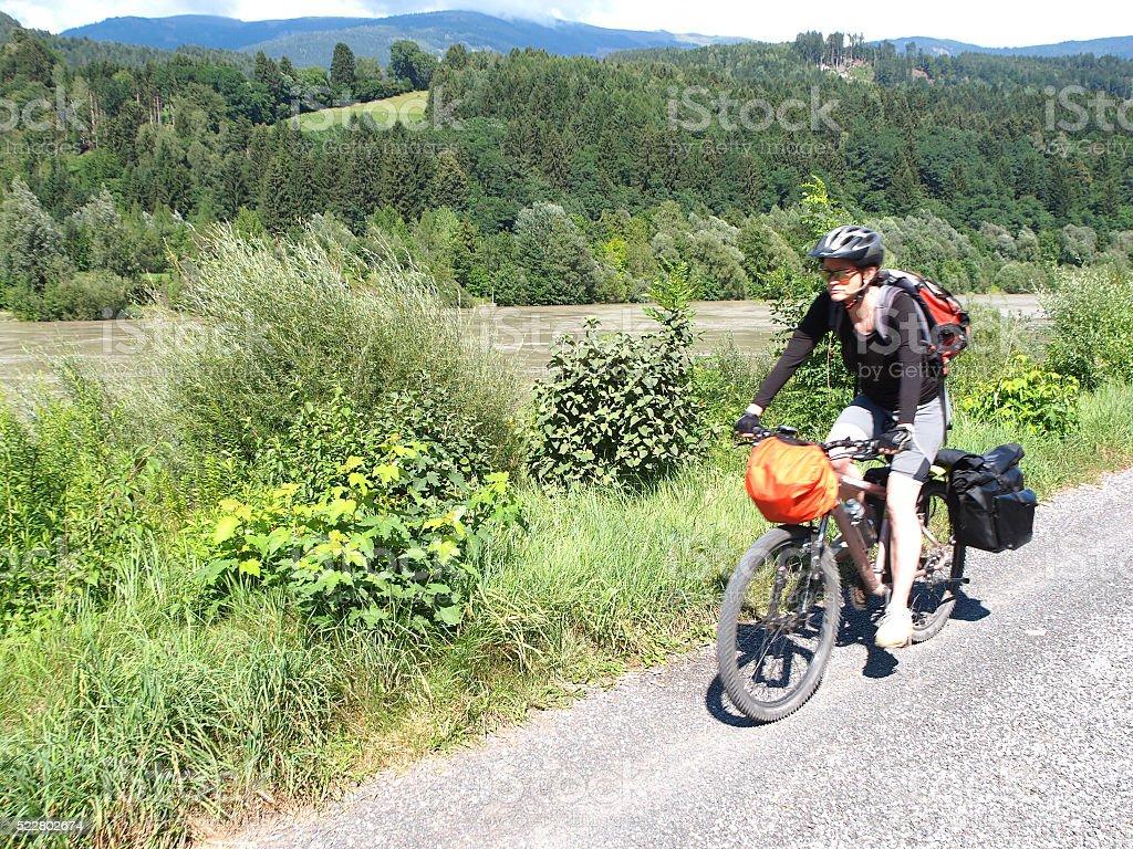 View of drau cycle path with biker near Spittal, Austria stock photo