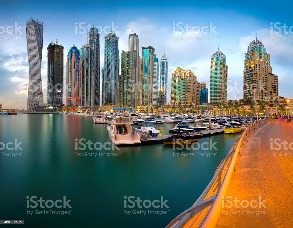 View of Dubai Skyline from marina with blue sky and water stock photo