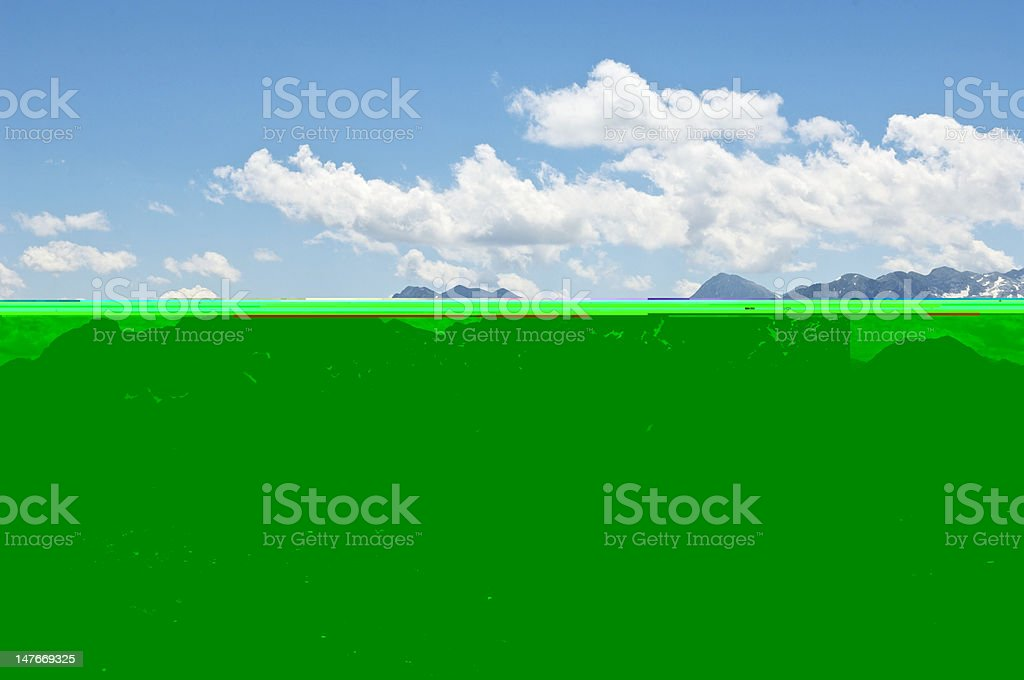 View of European Alps with Small Village in the Foreground stock photo