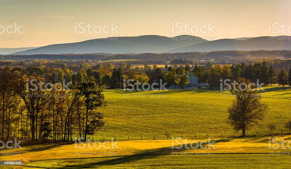 View of farm fields and distant mountains from Longstreet Observ stock photo