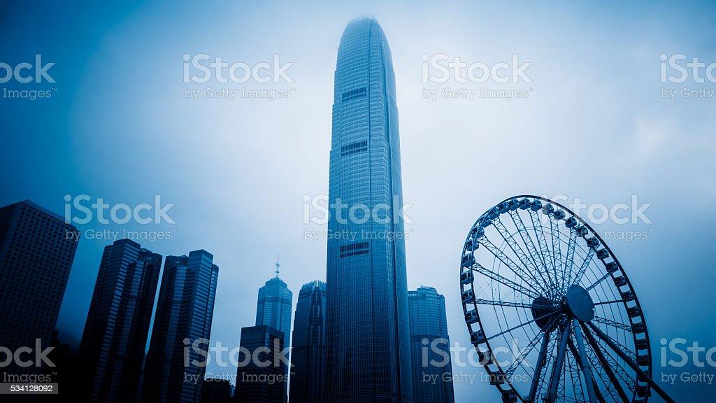 view of ferris wheel and skyscraper stock photo
