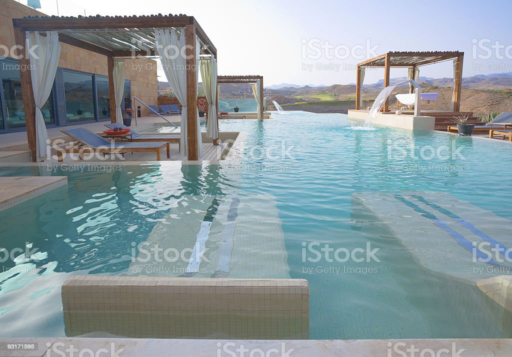 View of fields from an outdoor pool with canopies royalty-free stock photo