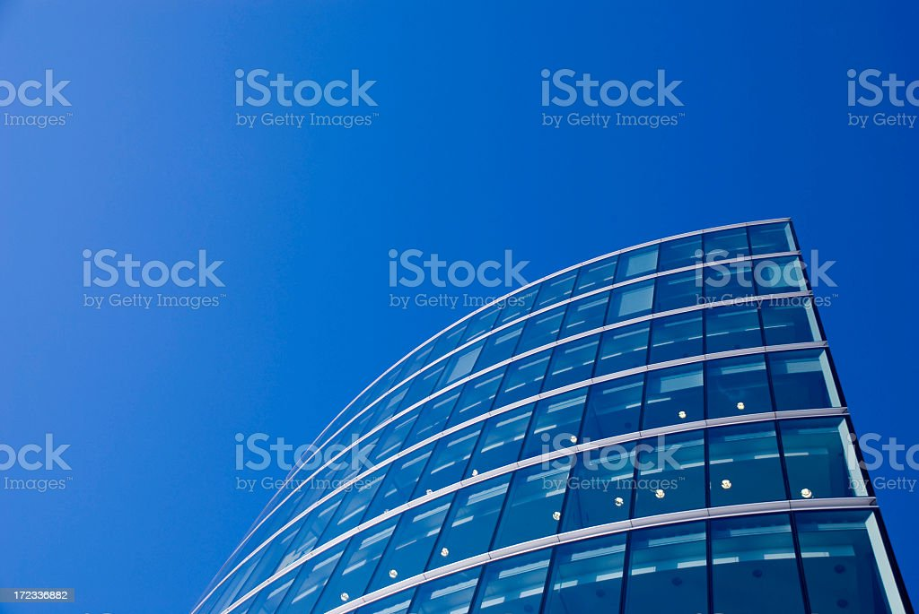 View of glass office, looking up towards the sky  royalty-free stock photo
