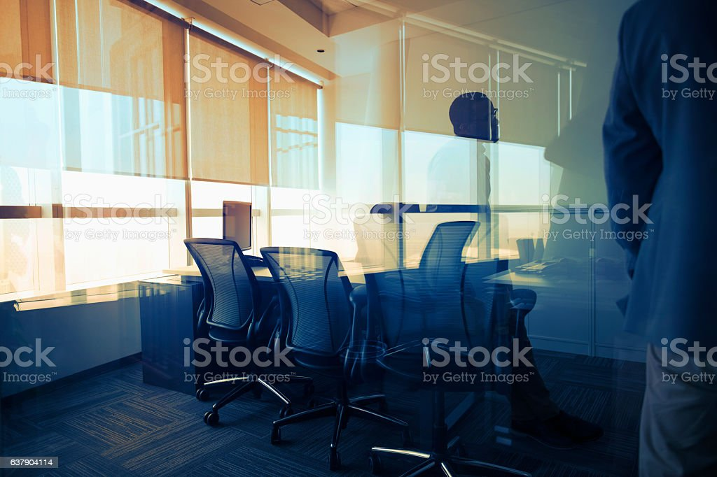 View of glass reflection in business office during meeting stock photo