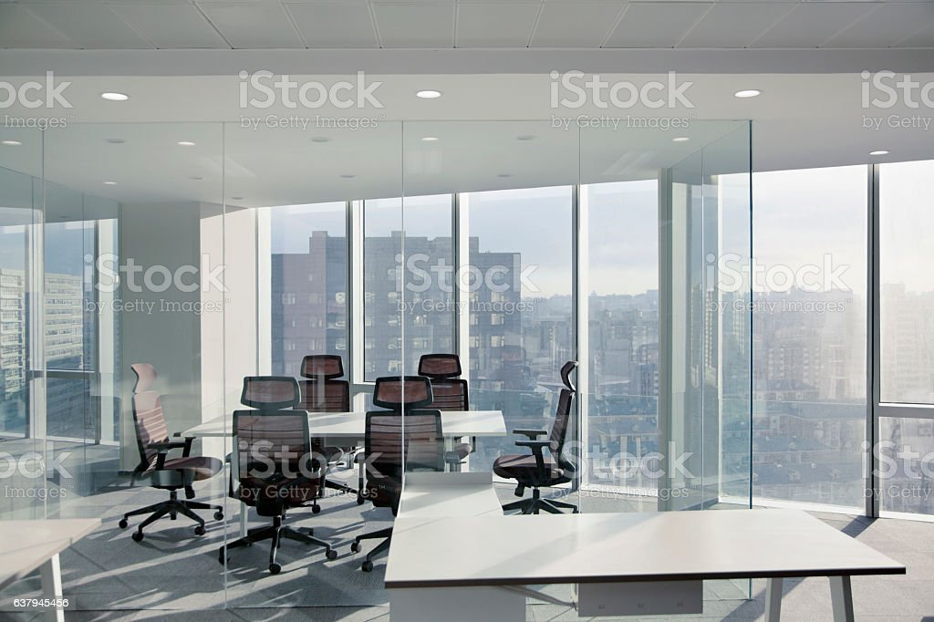 View of glass walled modern conference room in urban city