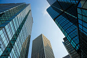 View of glass-paneled Hong Kong buildings as seen from below
