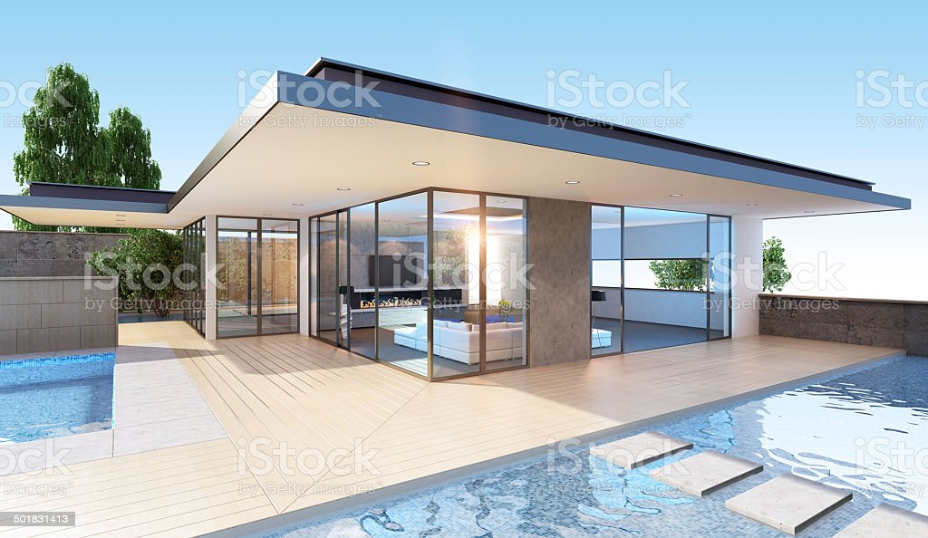View of glass-walled villa exterior with pool stock photo