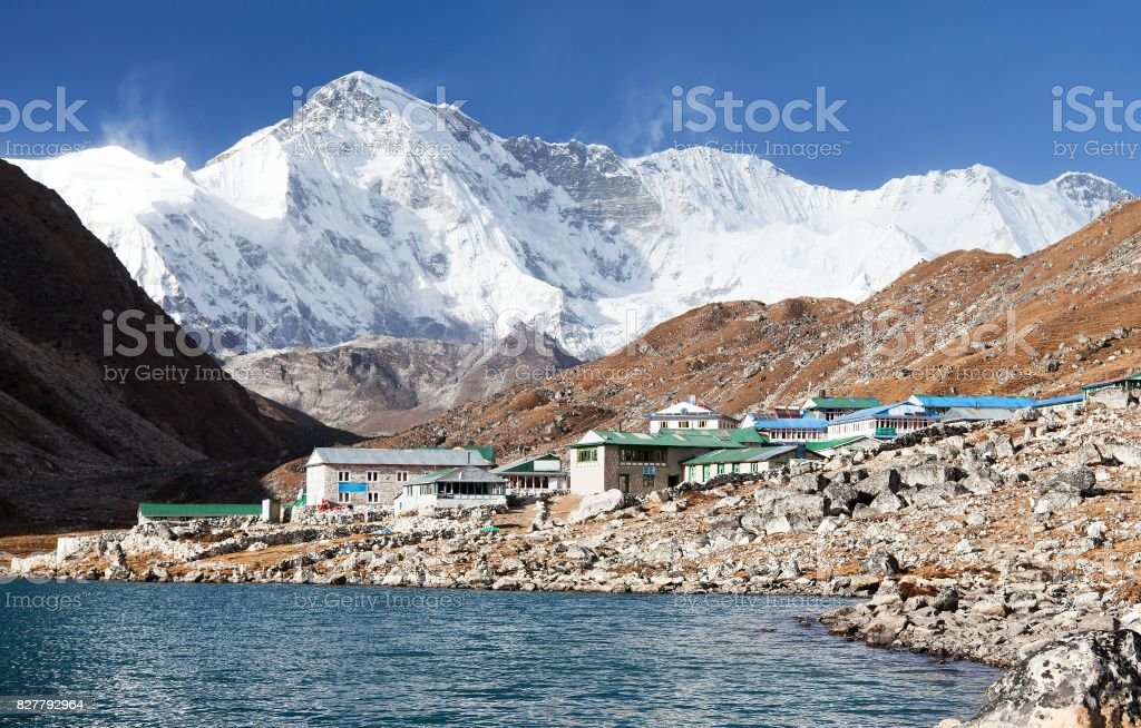 View of Gokyo lake and village with mount Cho Oyu stock photo