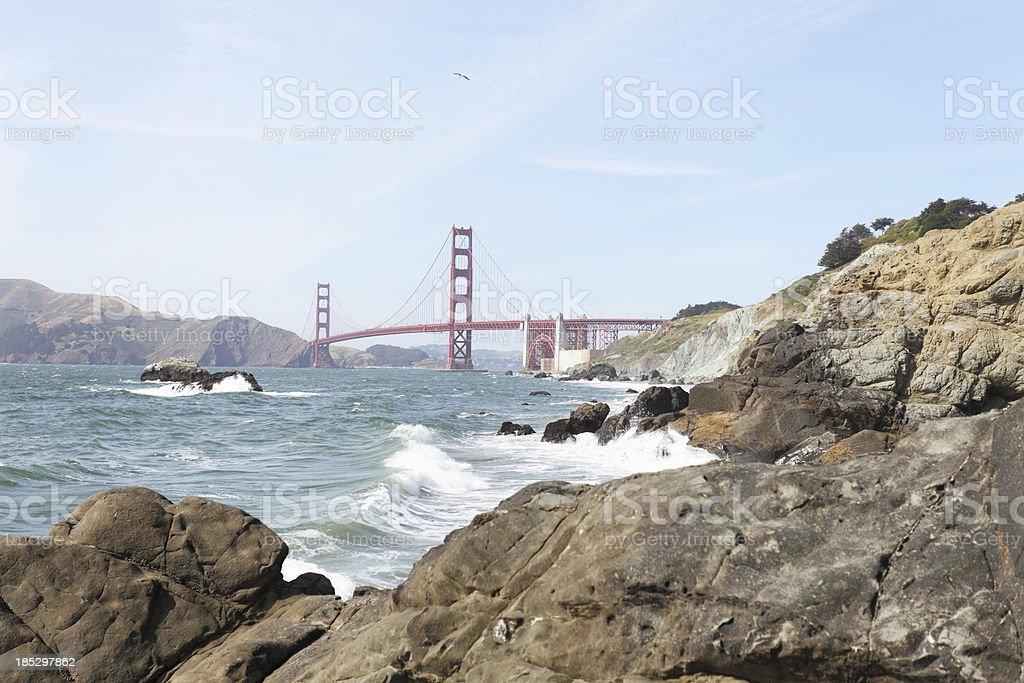view of Golden Gate Bridge behind rocks San Francisco stock photo