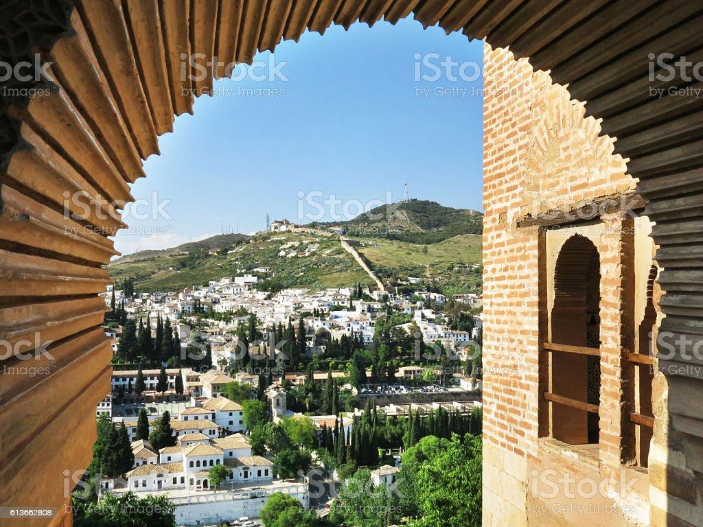 View of Granada through Alhambra stock photo