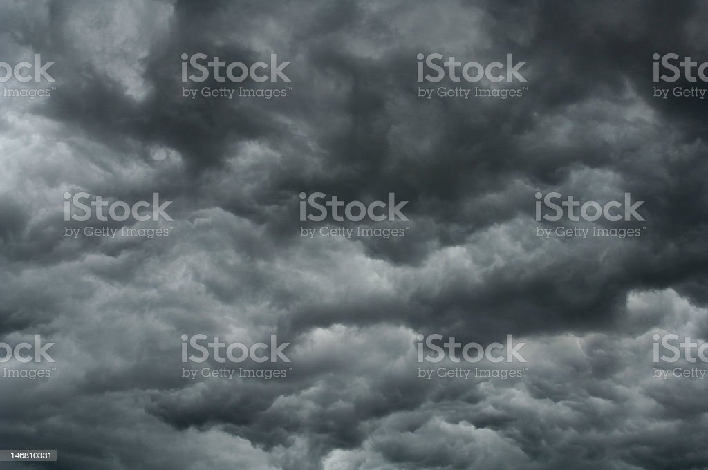 A view of gray muggy storm clouds stock photo