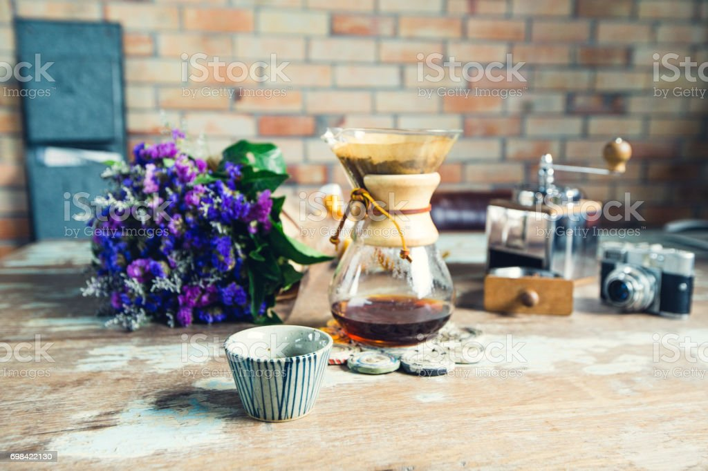 view of ground coffee pouring water on coffee ground with filter,...