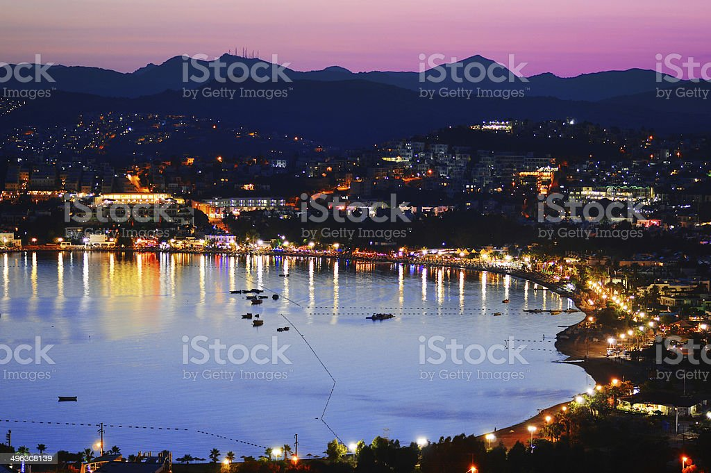 View of Gumbet Bay by night. Turkish Riviera. stock photo