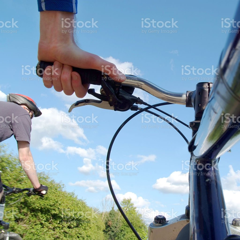 View of hands while mountain biking in scenic area. royalty-free stock photo