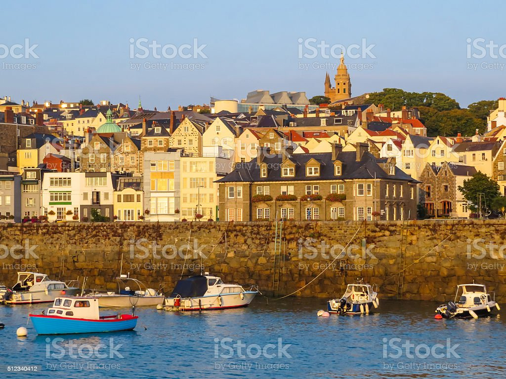 View of harbor Saint Peter Port at sunrise stock photo