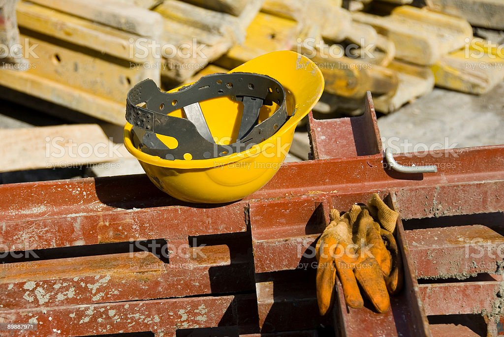 View of hard hat and gloves at construction site stock photo