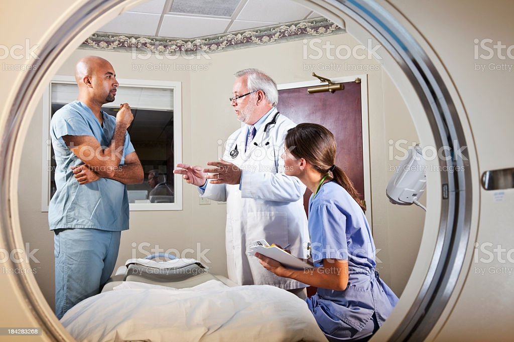 View of healthcare workers through CT scanner royalty-free stock photo