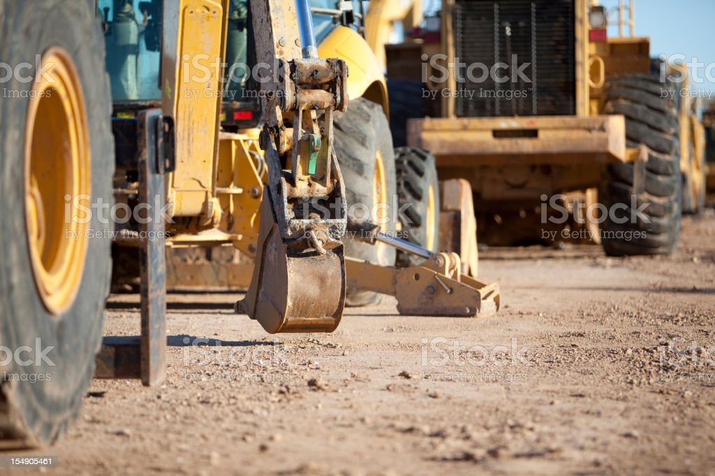 View of heavy road construction equipment on a dirt road stock photo