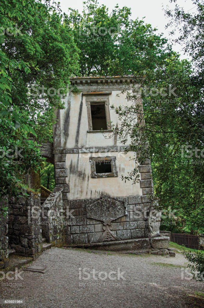View of house amidst the vegetation in the Park of Bomarzo. stock photo