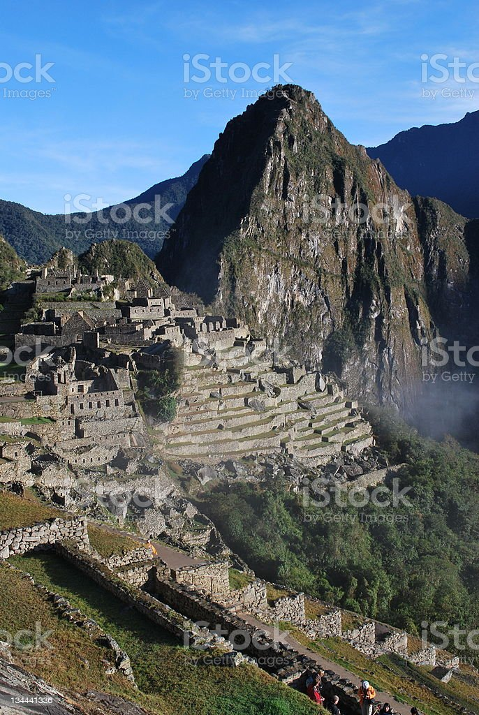 View of Huayna Picchu in background with ruins Peru stock photo