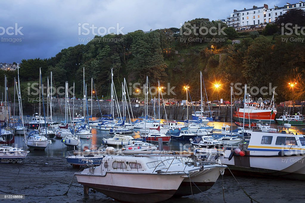 View of Ilfracombe harbour at dusk stock photo