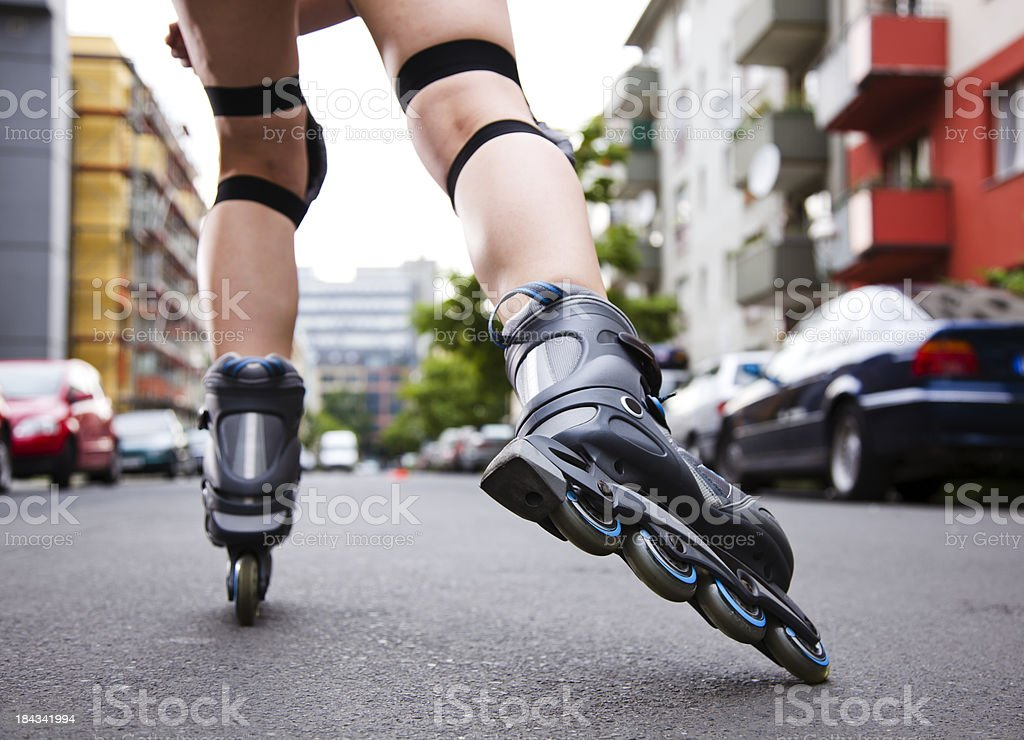 View of Inline Skater Skating away from the Camera stock photo