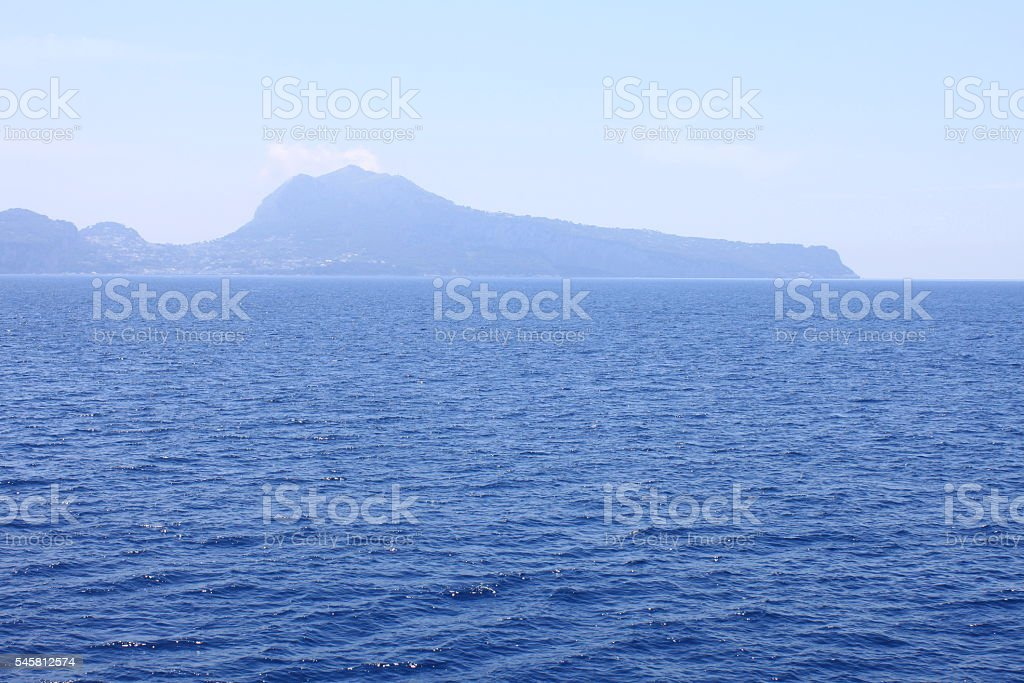 View of island of Capri from Tyrrhenian Sea in clear weather. stock photo