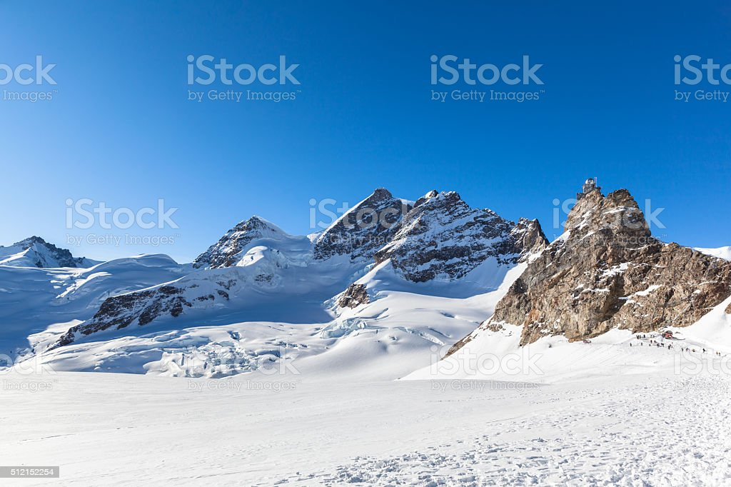 View of Jungfrau and The Sphinx Observatory from Jungfraujoch stock photo