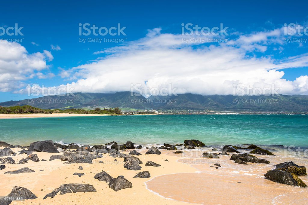 View of Kahului from Kanaha Beach in Maui stock photo