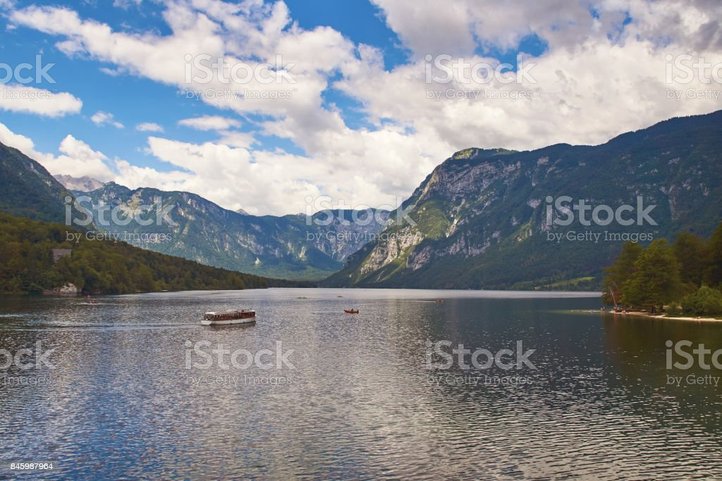 View of lake Bohinj with the ship sailing across it stock photo