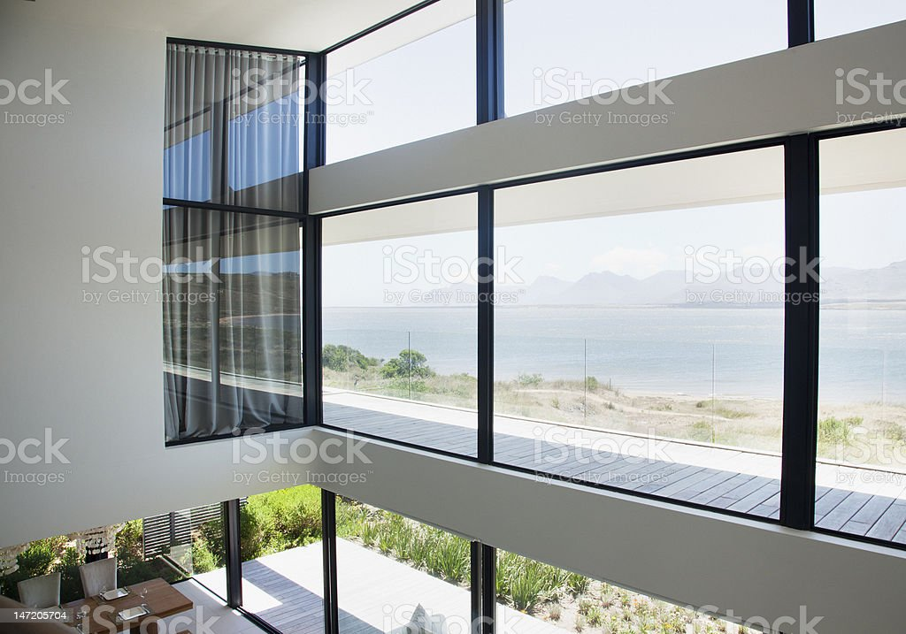 View of lake from loft of modern house royalty-free stock photo